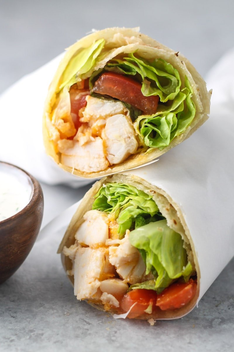 Two buffalo chicken wrap halves stacked on top of one another.