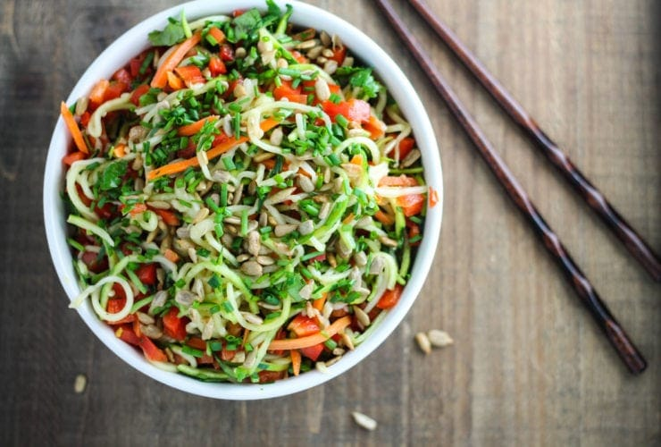 Overhead shot of low FODMAP Asian zoodle salad with chopsticks