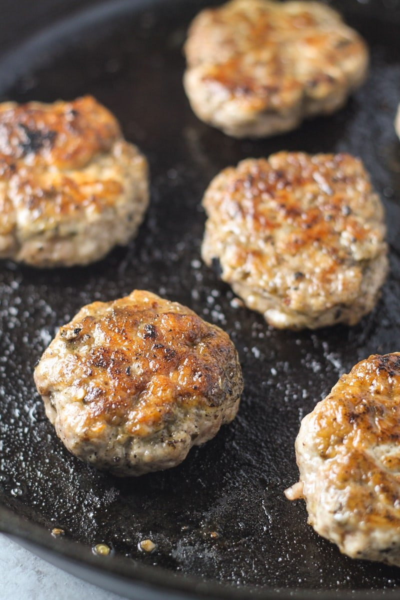 A just-cooked breakfast sausage patties in a skillet