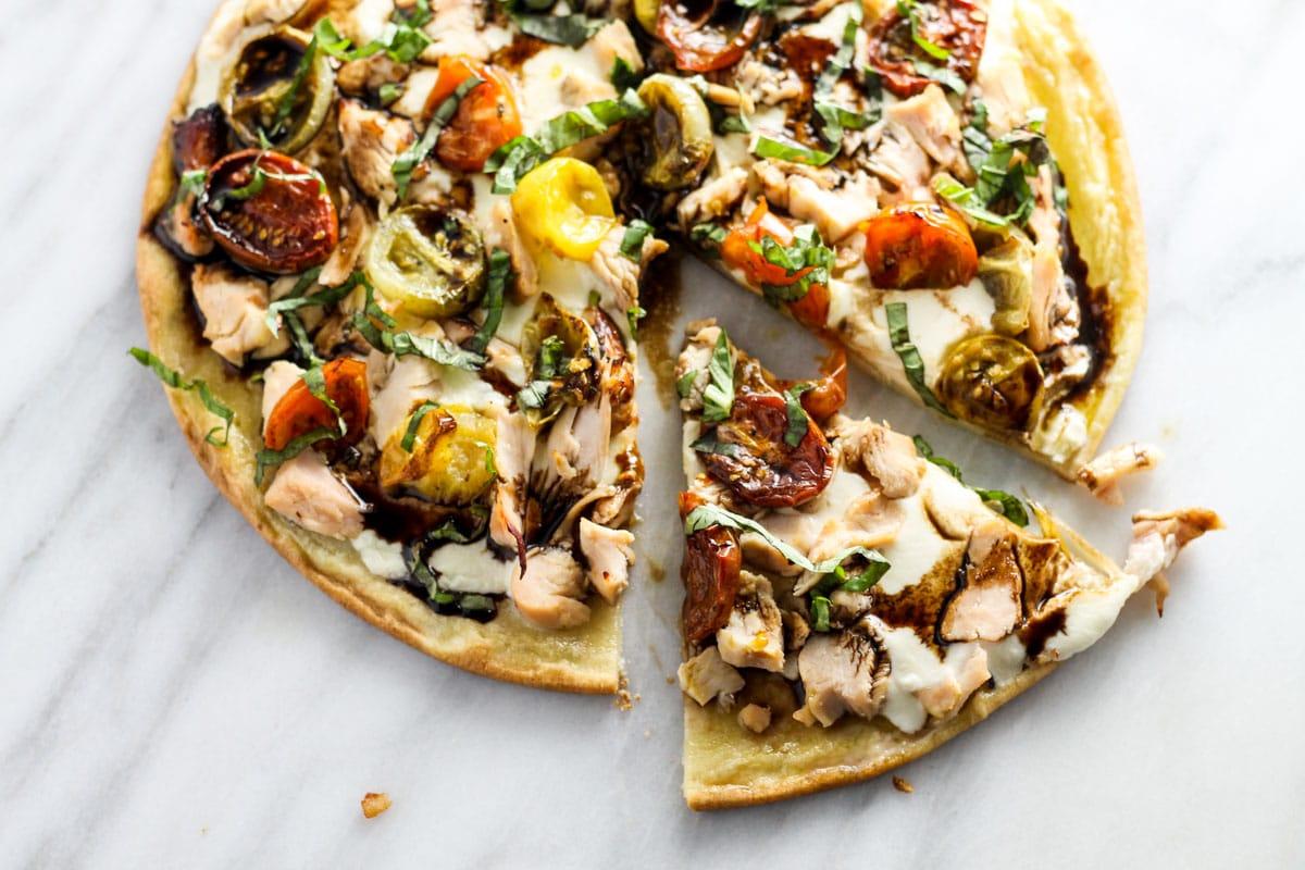 Vertical shot of low FODMAP bruschetta pizza with chicken