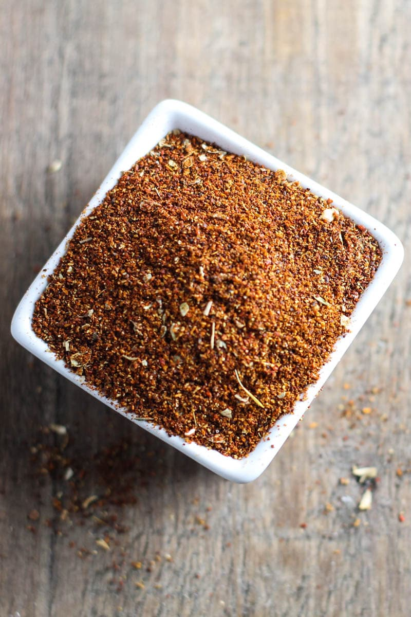 Overhead shot of small square bowl filled with low FODMAP taco seasoning