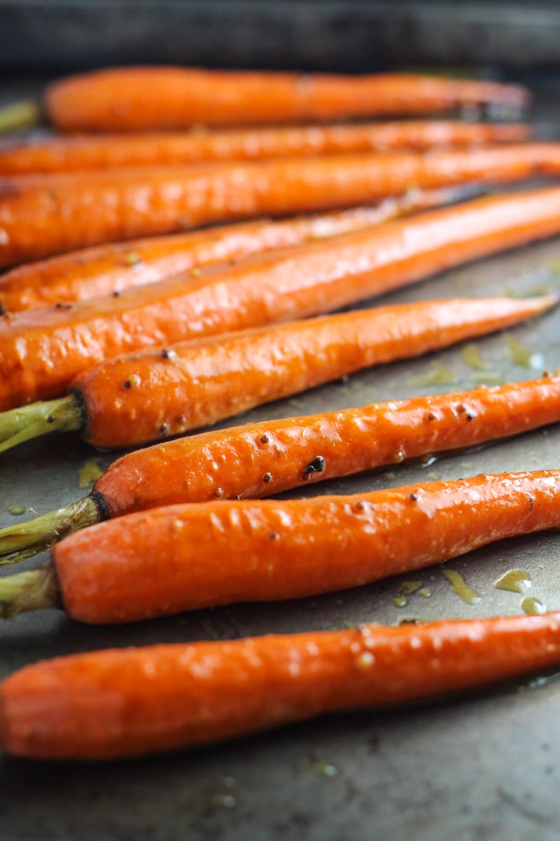 Roasted carrots on a sheet pan.