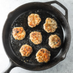 A cast-iron skillet filled with low FODMAP breakfast sausage patties