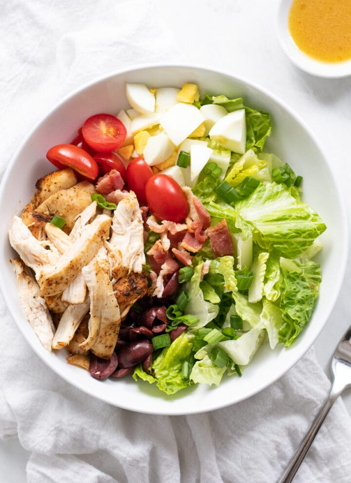 Cobb salad in a shallow white bowl.