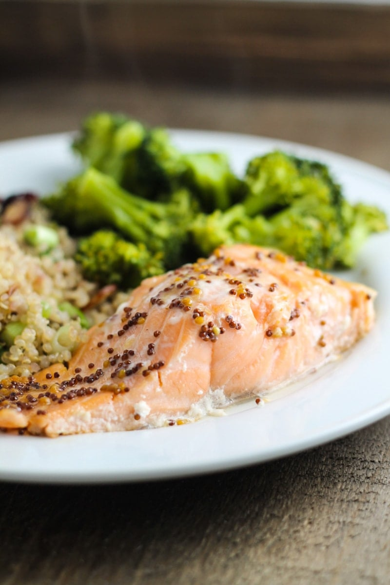 Low FODMAP maple-mustard salmon on a plate with broccoli.