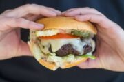 Hands holding low FODMAP California burger