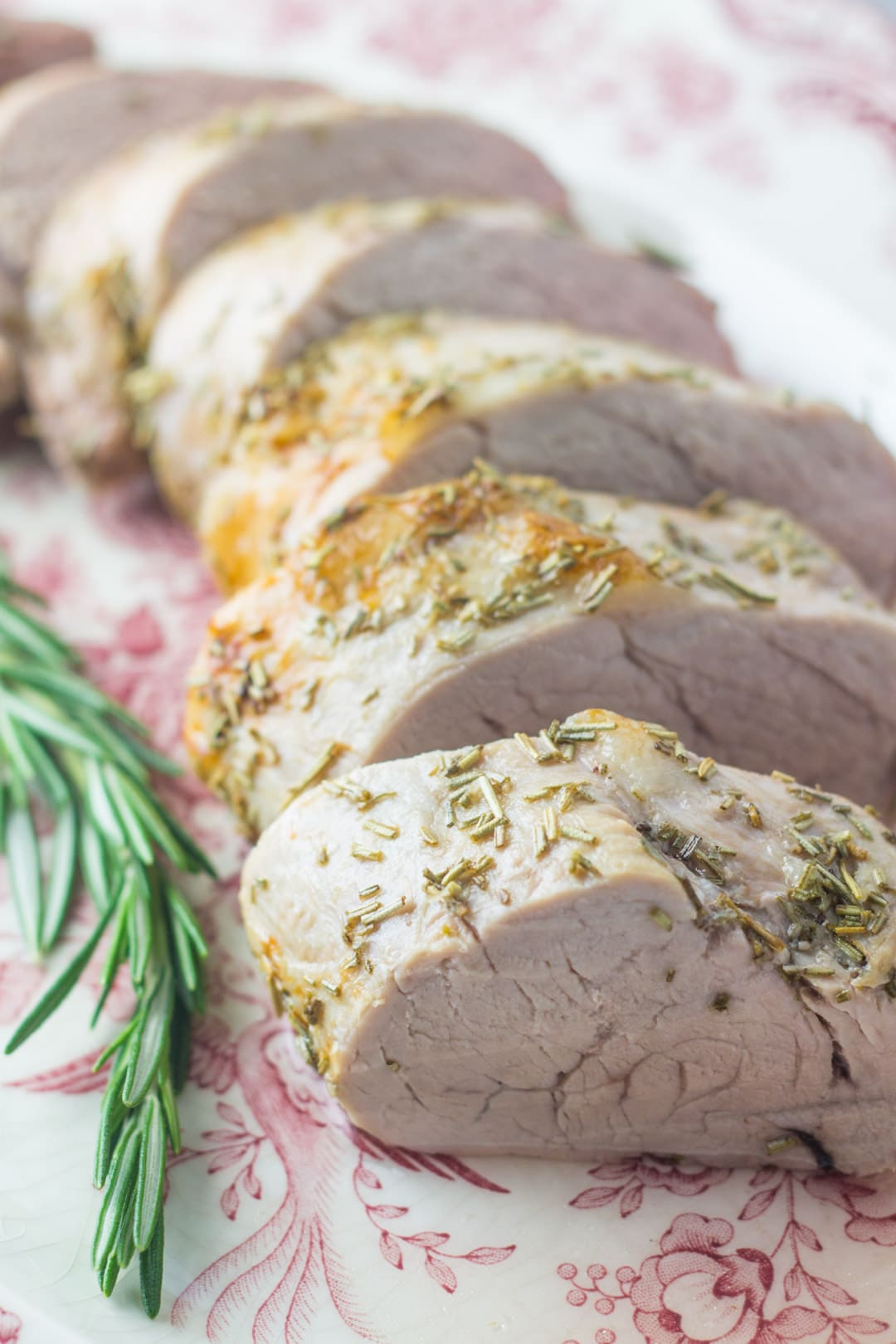 Slices of low FODMAP pork tenderloin with rosemary
