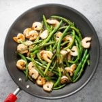 Shrimp and green bean stir fry in skillet