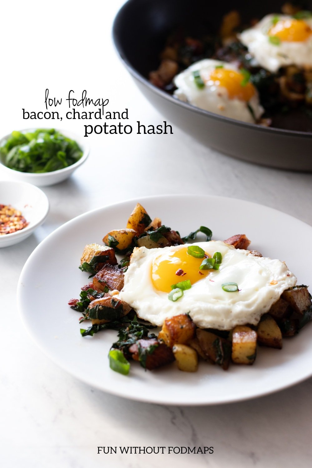 A close up of a plate of low FODMAP bacon, chard and potato hash.