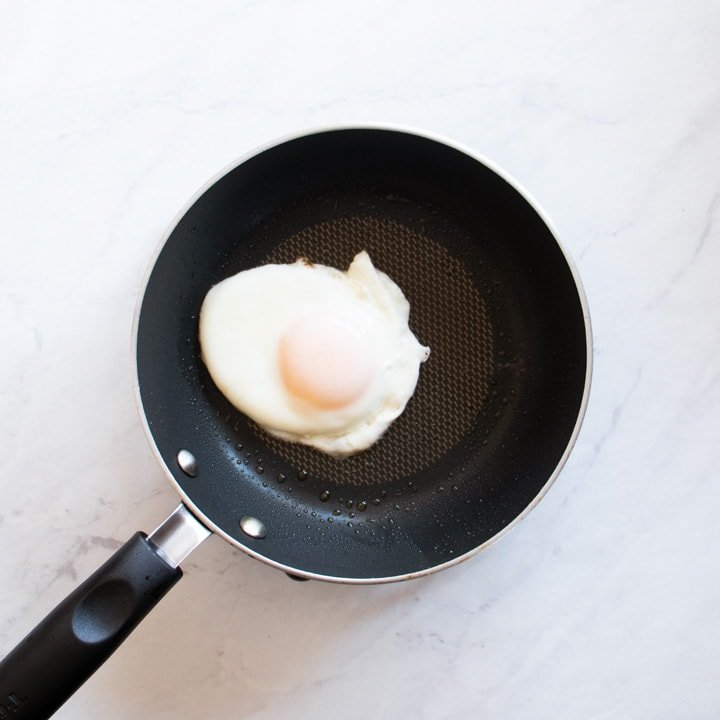 A small skillet filled with a fried egg.