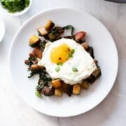 A square image of low FODMAP bacon, chard and potato hash.
