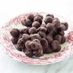 Plate of low FODMAP dark chocolate blueberry mac nut bites