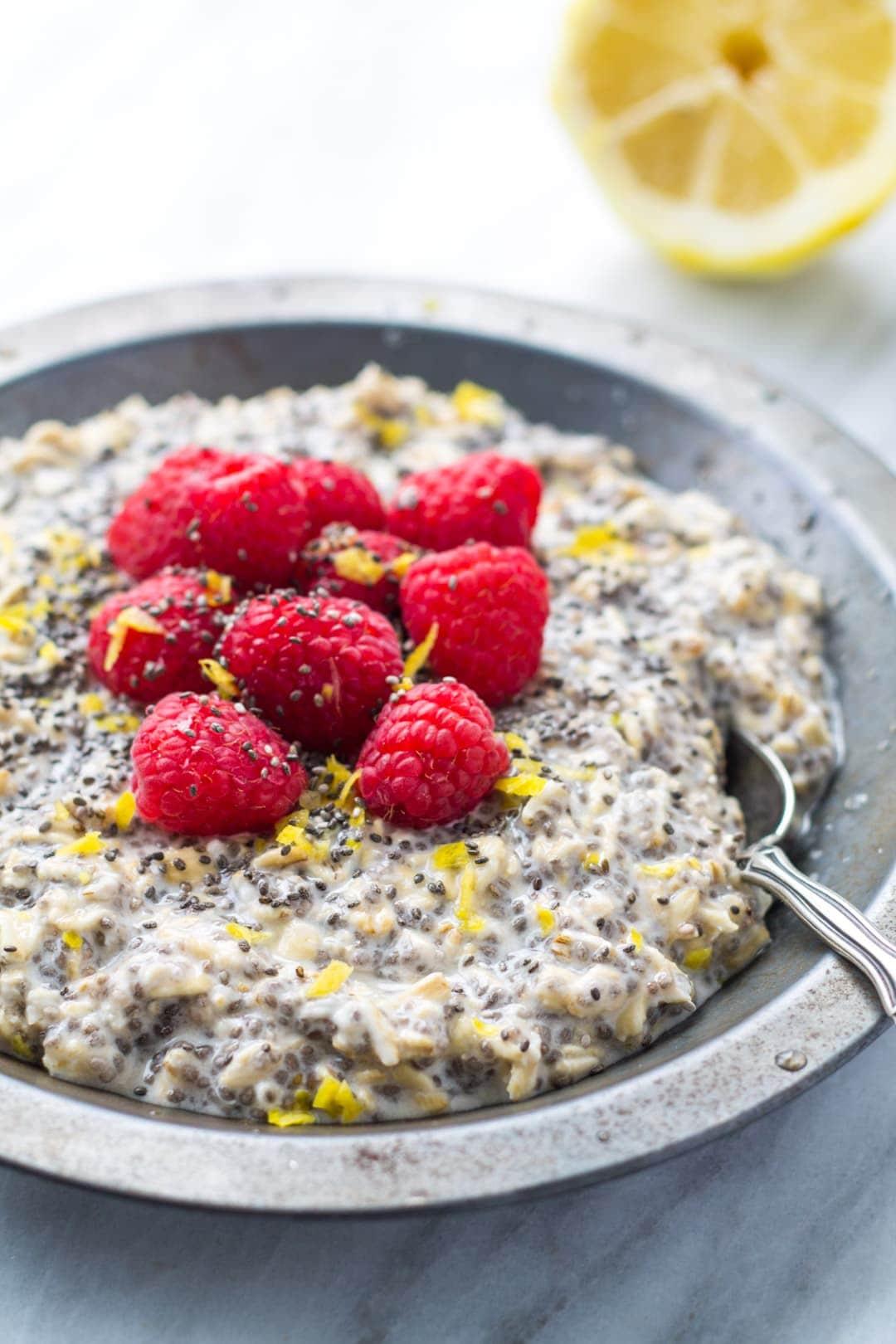 Close up vertical shot of low FODMAP lemon raspberry overnight oats