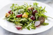 Side shot of low FODMAP arugula salad with grapes