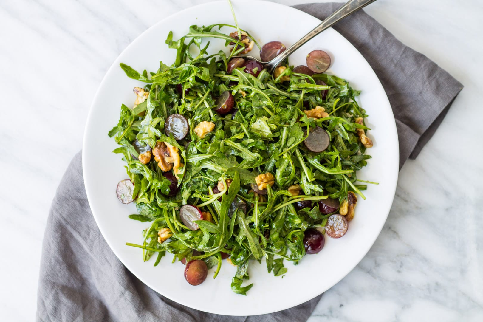 Overhead shot of low FODMAP arugula salad with grapes