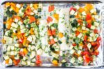Horizontal overhead shot of low FODMAP Lemon Cod Sheet Pan Meal
