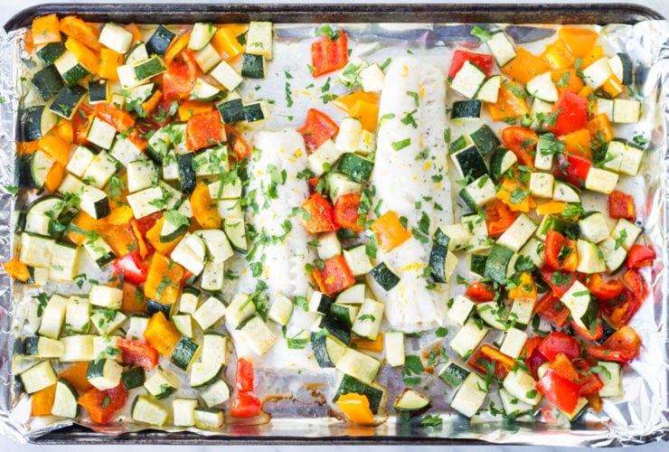 Horizontal overhead shot of low FODMAP Lemon Cod Sheet Pan Meal
