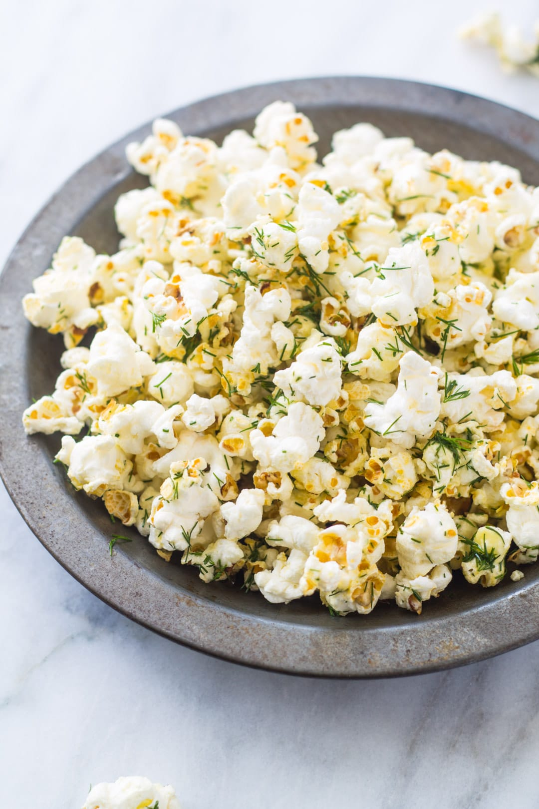 Bowl of low FODMAP dill pickle popcorn