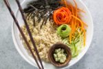 A low FODMAP sushi bowl with chopsticks