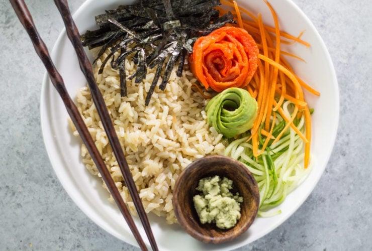 A low FODMAP sushi bowl with chopsticks