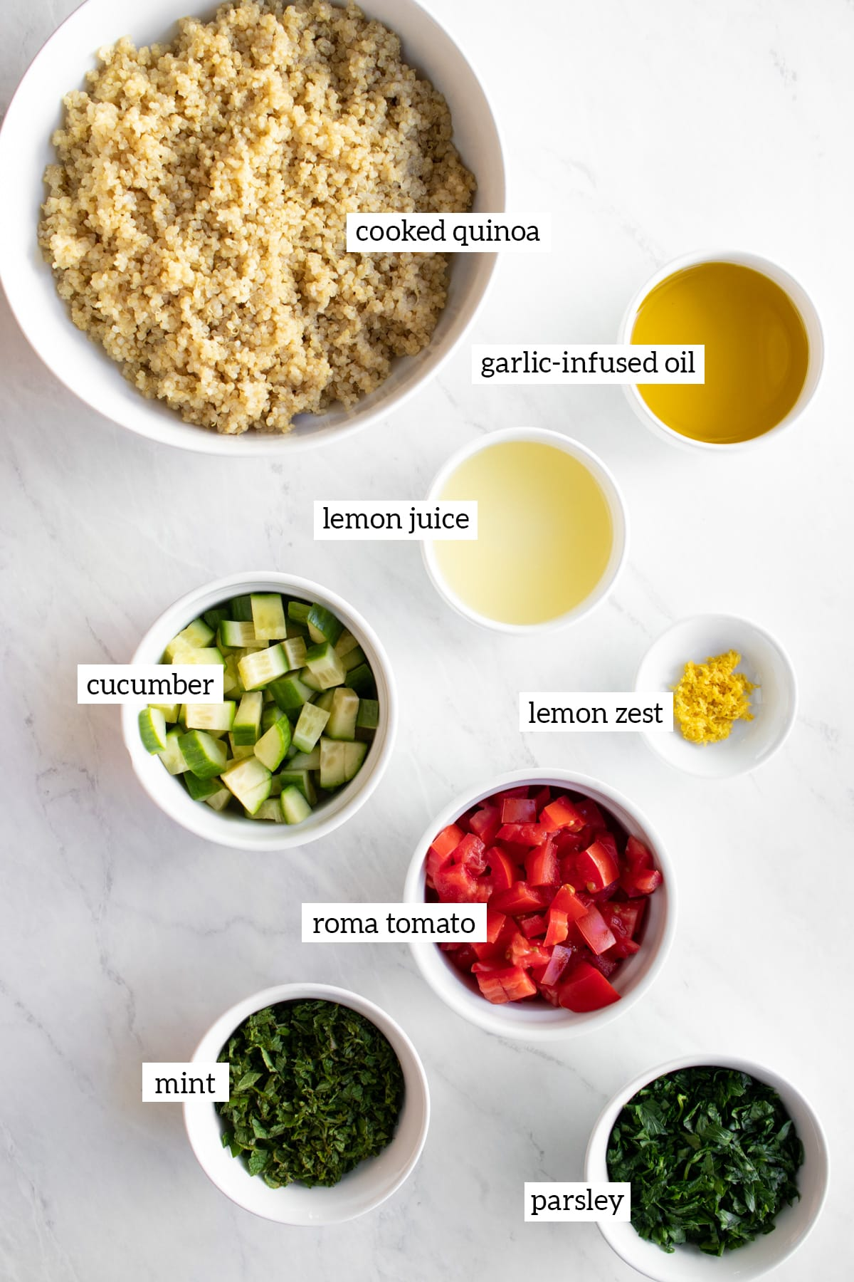 Ingredients needed for low FODMAP quinoa tabbouleh measured out into white bowls