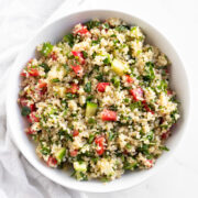 A shallow white bowl filled with quinoa tabbouleh