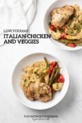 "Two bowls with baked chicken, green beans, cherry tomatoes, and canned artichokes over cooked quinoa sit on a white marble counter. In the white space, black text reads ""Low FODMAP Italian Chicken and Veggies"""