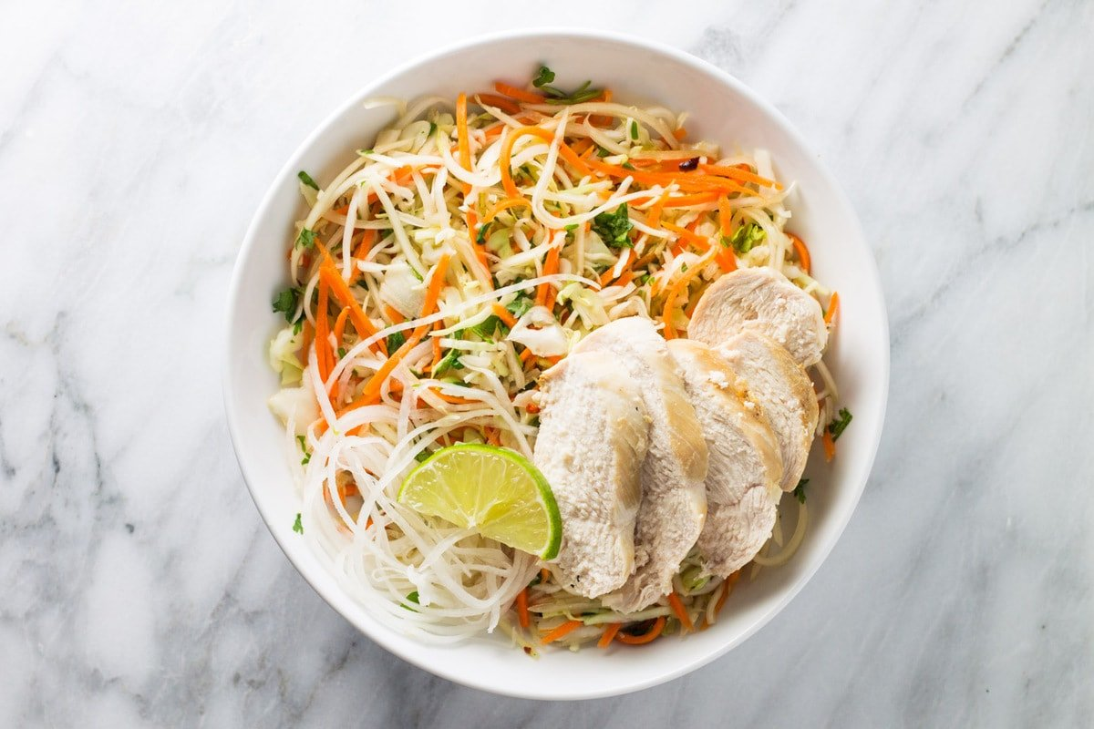 Bowl of low FODMAP Thai citrus salad