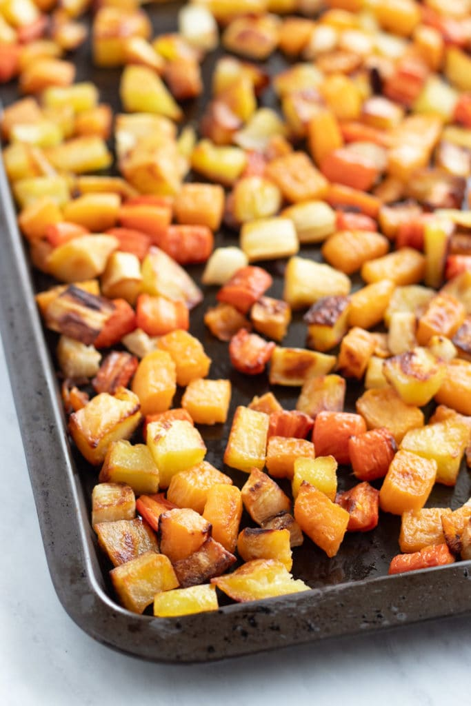 A sheet pan filled with low FODMAP roasted root veggies