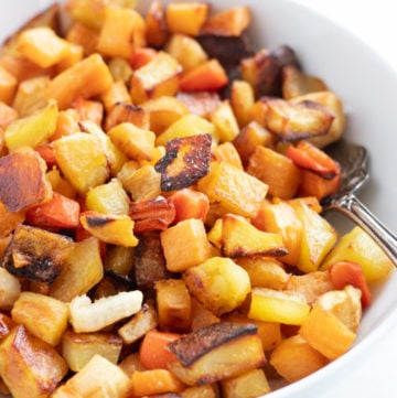 A white bowl filled with low FODMAP roasted root veggies