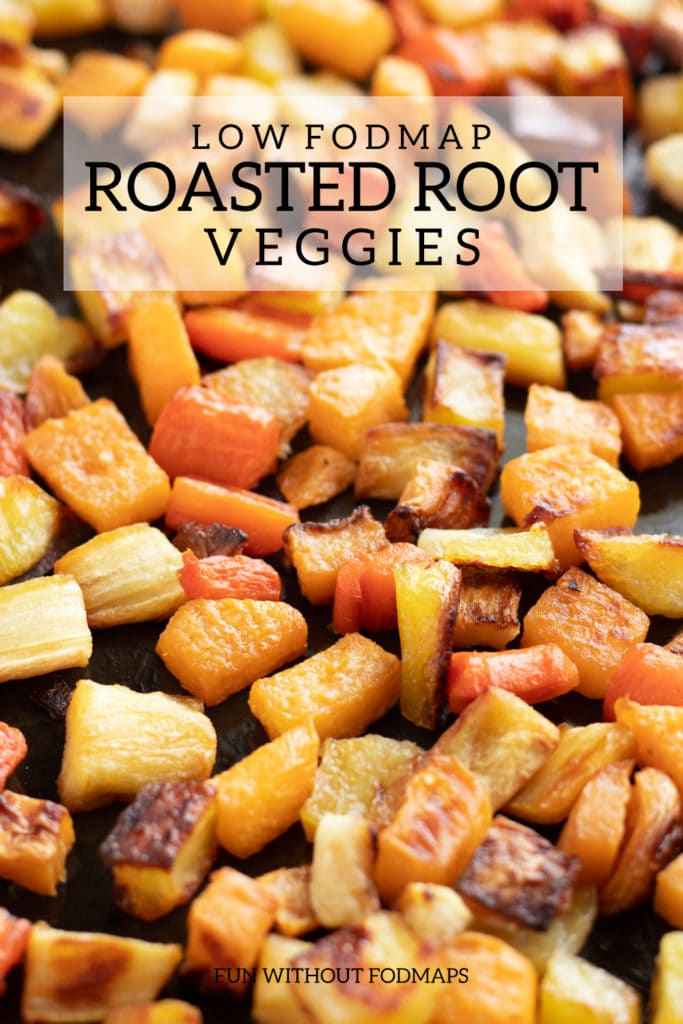 A pan of low FODMAP roasted root veggies with a text overlay reading low FODMAP roasted root veggies