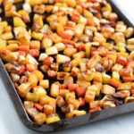 A pan of low FODMAP roasted root veggies - parsnips, carrots, rutabaga, and potatoes