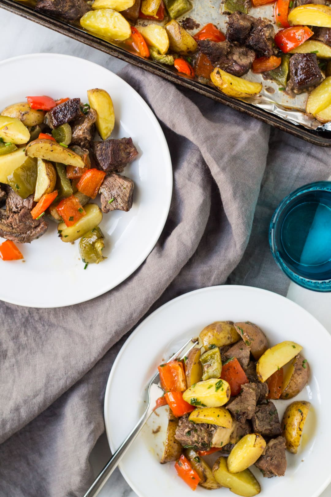Plates of low FODMAP Steak and Potatoes Sheet Pan Meal