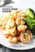 """A close up of maple-dijon shrimp. In the white space above, a text overlay reads """"Low FODMAP Maple Dijon Shrimp."""""""