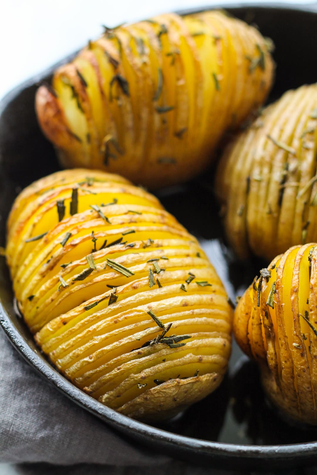 Close up of low FODMAP Hasselback Potatoes with Rosemary
