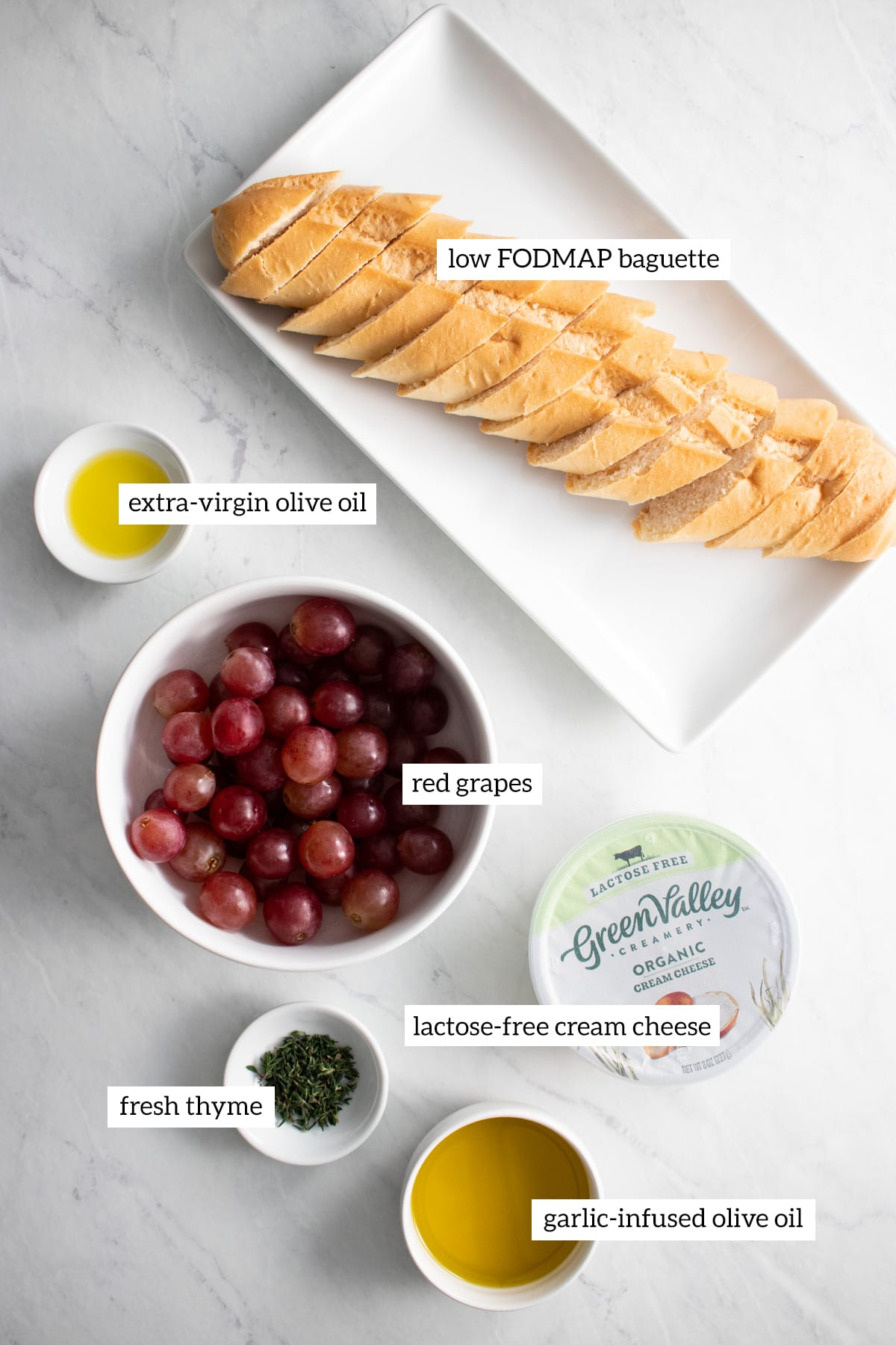 Ingredients for low FODMAP crostini with roasted grapes and thyme are measured out into individual bowls.