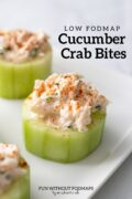 """Three cucumber bites filled with a creamy crab mixture sit on a rectangular plate. In the white space above, a black text overlay reads """"Low FODMAP Cucumber Crab Bites."""""""
