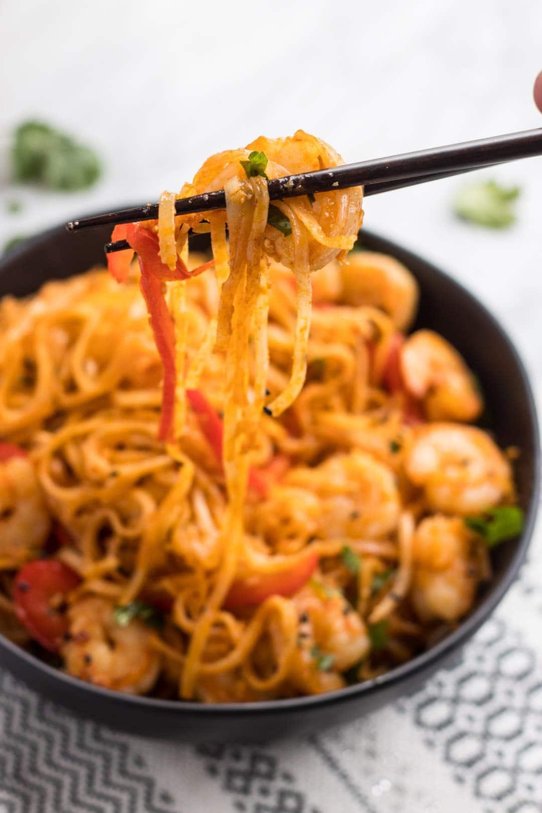Chopsticks holding Low FODMAP Pad Thai with Shrimp