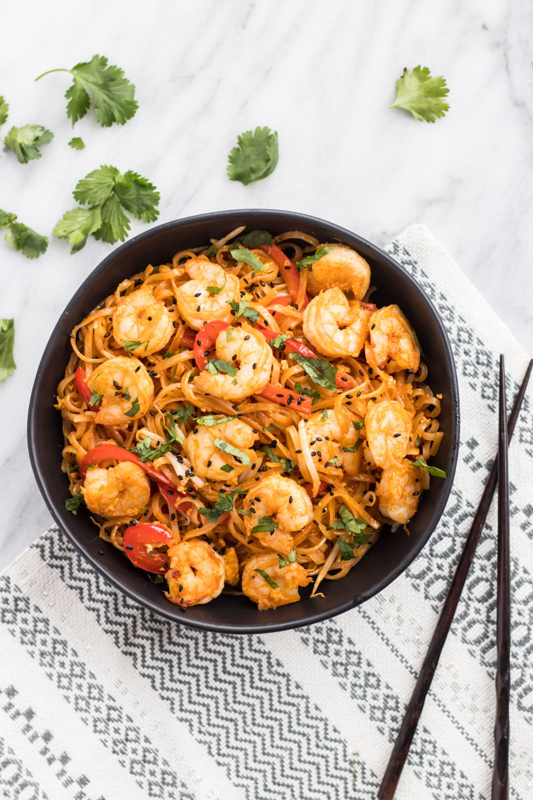 Bowl of low FODMAP Pad Thai with Shrimp and Chopsticks