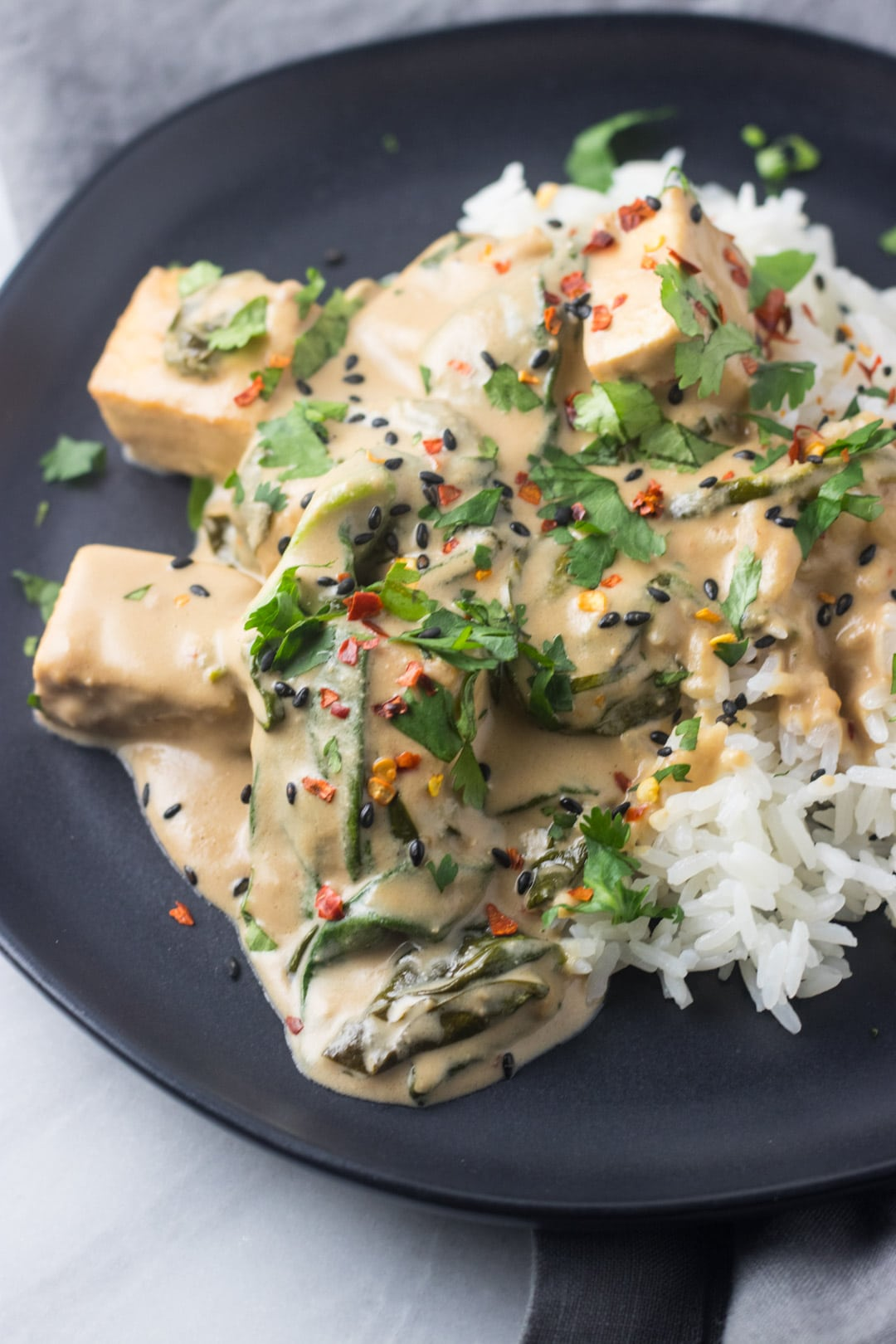 Low FODMAP Thai Pra Ram Tofu on a black plate