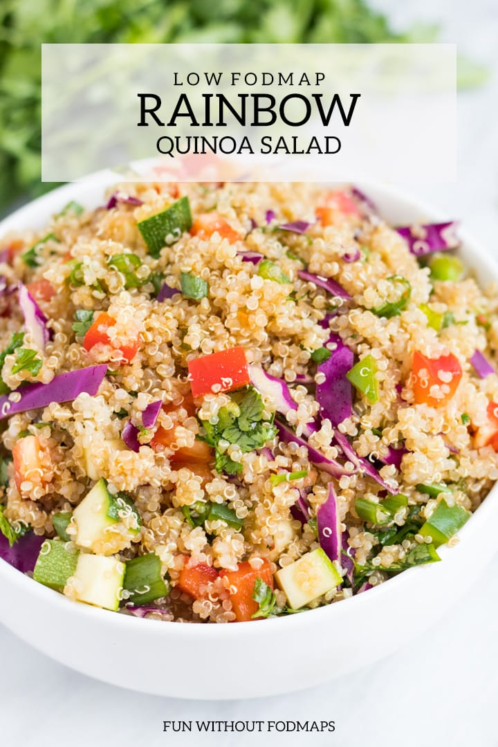 A close up of low FODMAP Rainbow Quinoa Salad. There is a white rectangle overlay with dark gray text that reads low FODMAP rainbow quinoa salad at the top of the image. Centered at the bottom it says FUN WITHOUT FODMAPS.