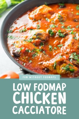 A nonstick skillet filled with low FODMAP chicken cacciatore and garnished with chopped Italian parsley.