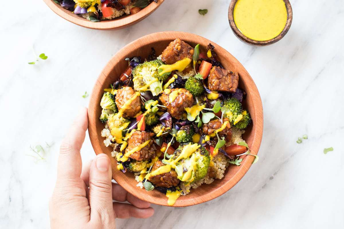 Hand holding a Low FODMAP Rainbow Bliss Bowl