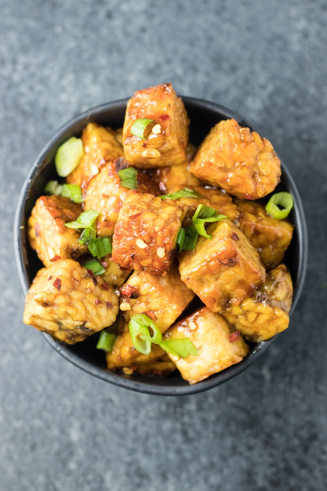 Fried tempeh cubes tossed in a maple-soy glaze and topped with sliced green onions