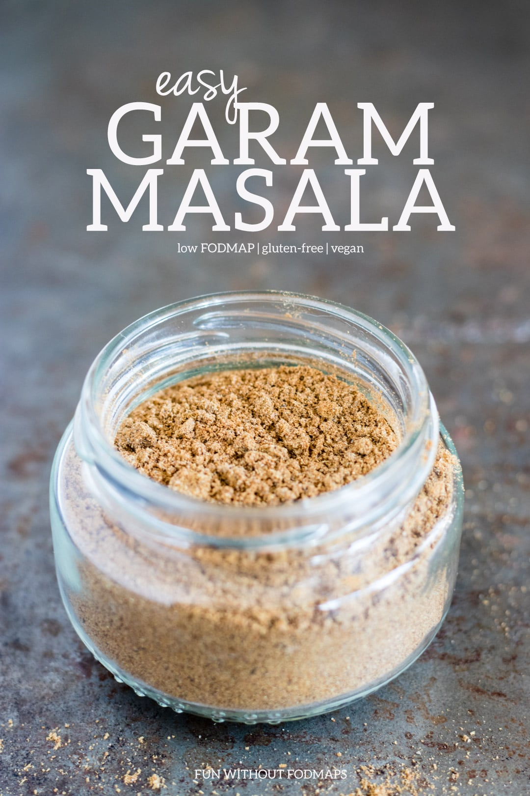 "Homemade spice blend in a small glass jar. White text in the space above reads ""Garam Masala - low FODMAP 