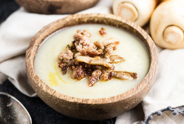 Low FODMAP Parsnip Soup topped with crispy pork and oyster mushrooms
