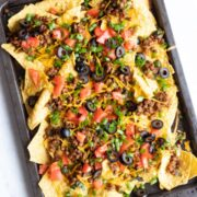 A sheet pan filled with loaded low FODMAP lentil nachos.