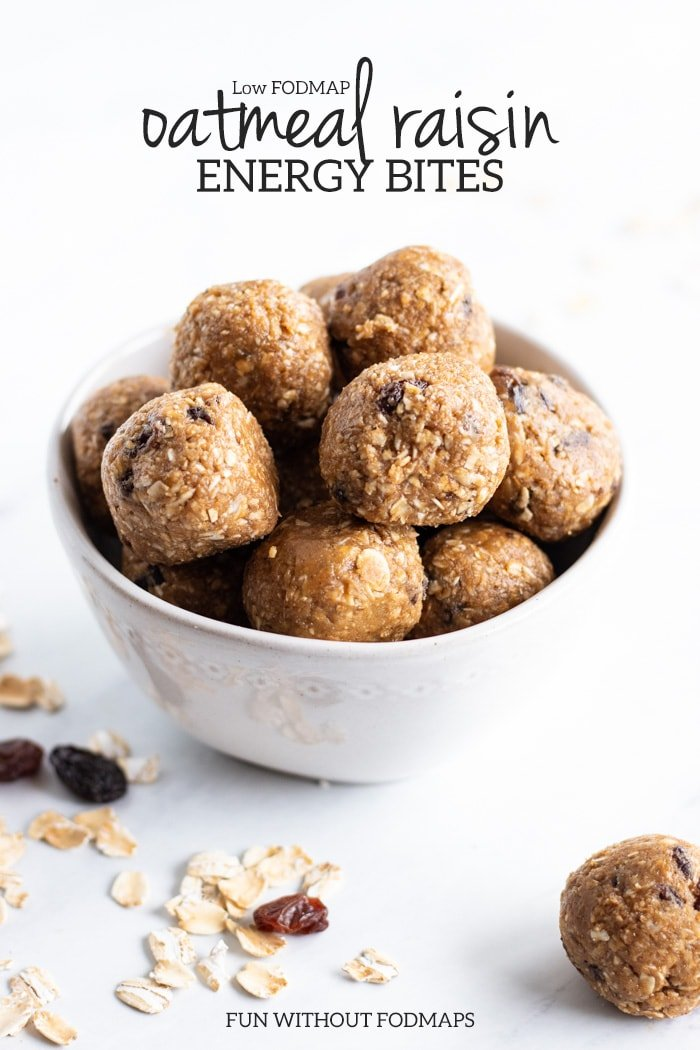 A close up of a white bowl filled with golf ball sized oatmeal energy bites. Dark gray text is centered at the top of the image reads Low FODMAP Oatmeal Energy Bites. FUN WITHOUT FODMAPS is also centered at the bottom.