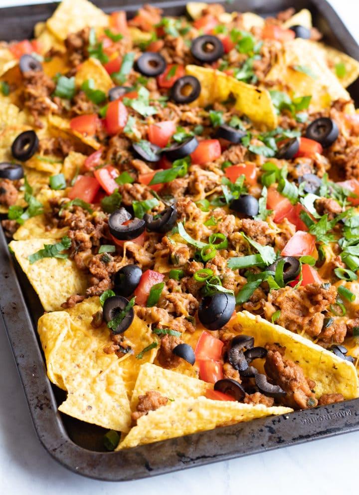 A rimmed baking sheet filled with low FODMAP sheet pan nachos.