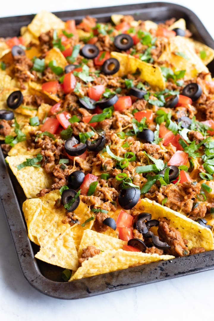 A rimmed baking sheet filled with low FODMAP sheet pan nachos.